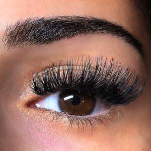 volume extreme silk d curl eyelash extensions closeup on brown eye
