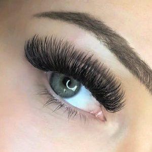 volume extreme silk d curl eyelash extensions closeup on blue eye