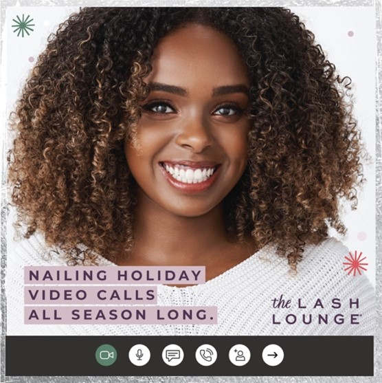 black woman with lash extensions smiling while on a video call