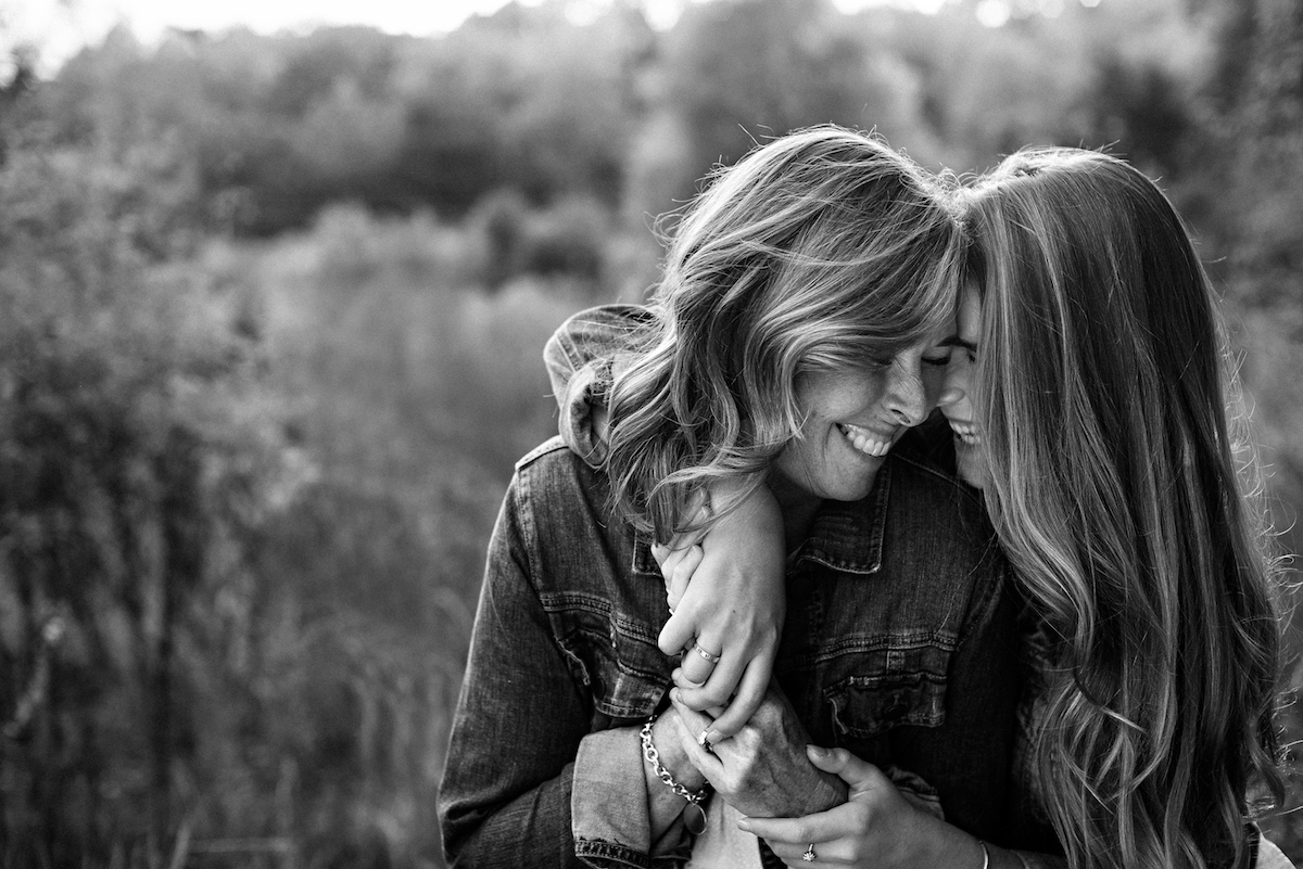 black and white photo of mother and grown daughter hugging
