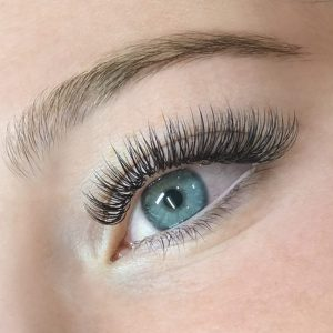 classic eyelash extensions closeup on brown eye