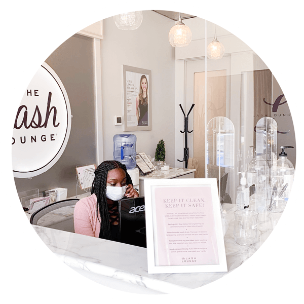 The Lash Lounge Receptionist With Mask Covid Safety