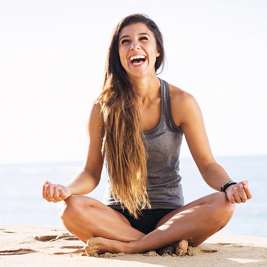woman meditating on beach after eyebrow threading