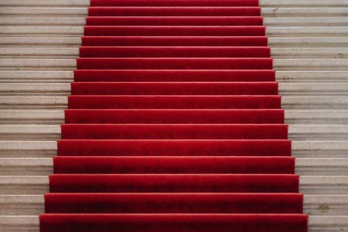 close up of the red carpet at the Met Gala leading up stairs