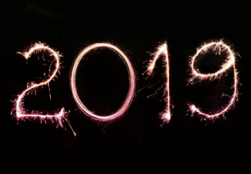 2019 written with sparklers in the dark sky at night