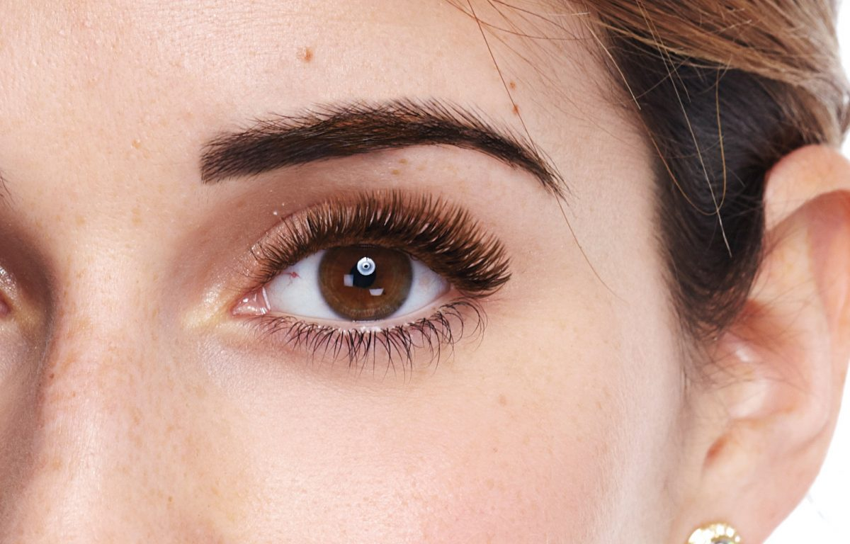 Photo of woman with beautiful top and bottom lash extensions