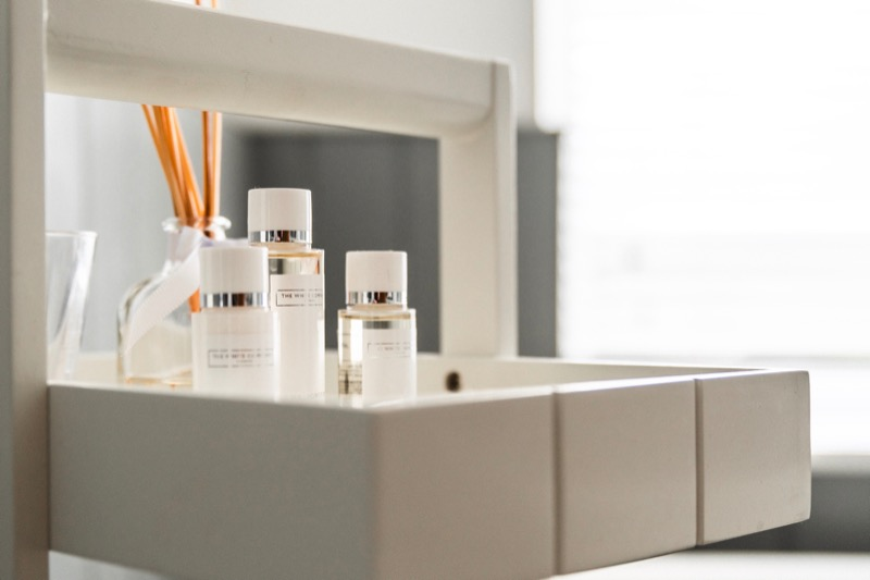 eyelash extension products placed on a shelf with diffuser in the back