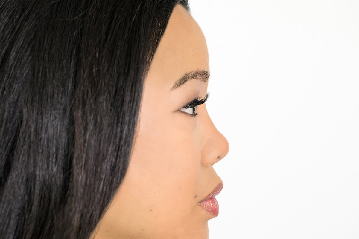 side profile of woman with lash extensions and natural makeup