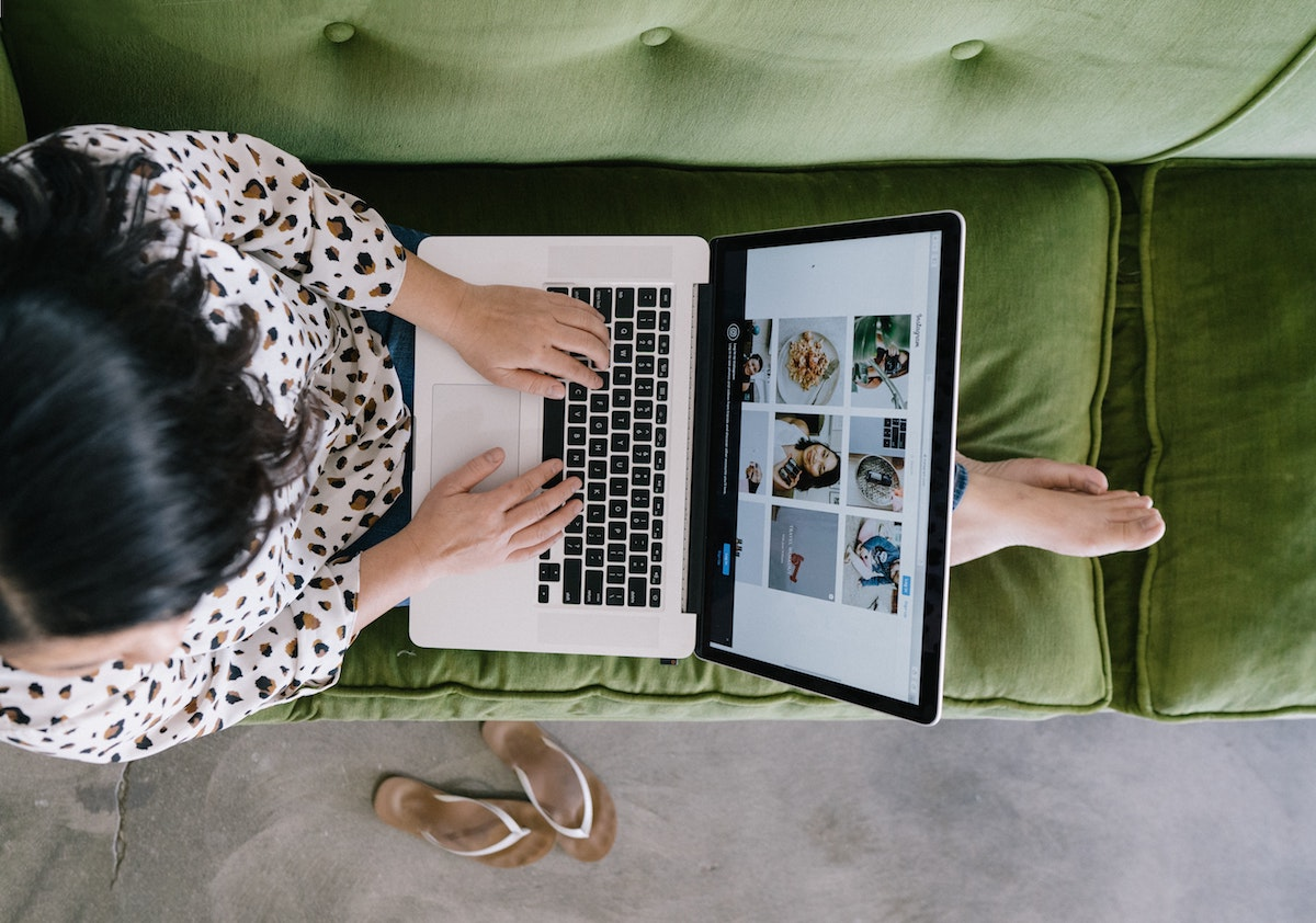 Woman relaxing on couch browsing the internet