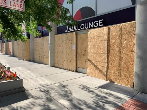 Exterior shot of The Lash Lounge Chicago– River North boarded up after riots and break-in at their salon