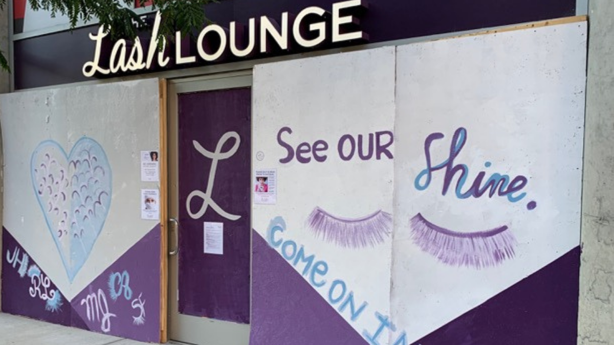 "a photo showing the exterior front of eyelash salon The Lash Lounge Chicago – River North and the mural painted along their store front with the words ""see our shine"""