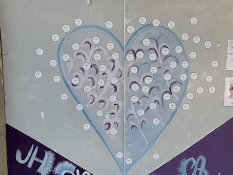 stickers placed by guests on the exterior mural outside of The Lash Lounge Chicago River North salon