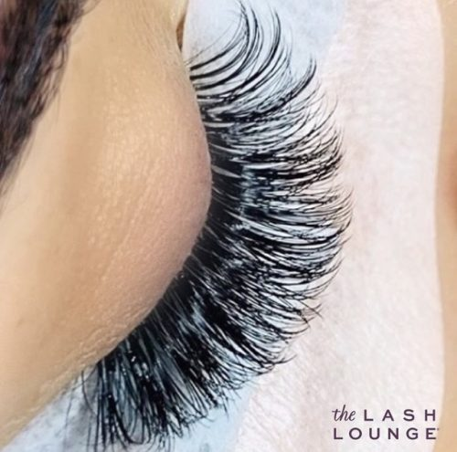 closeup of eye closed with long eyelash extensions full fluffy volume