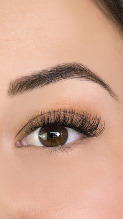 close up of woman with beautiful shaped eyebrows