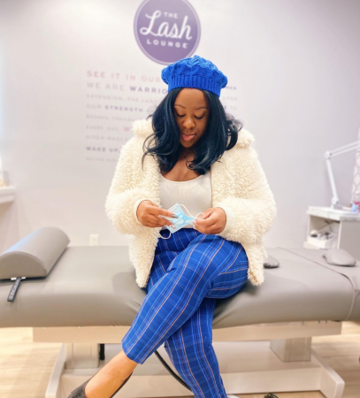 black woman stylist lash lounge thinking