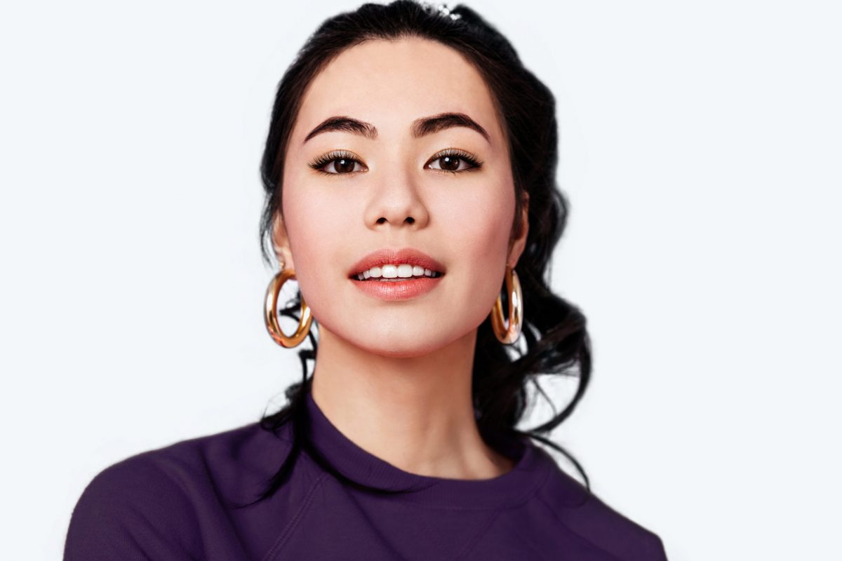 pretty asian woman with eyelash extensions and threaded eyebrows