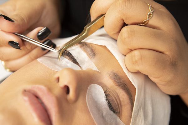 Woman receiving regular refill at The Lash Lounge to take care of her lash extensions