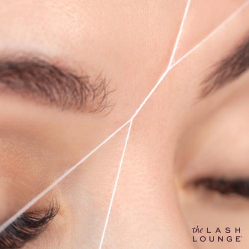 closeup of woman eyebrows while she gets an eyebrow threading service