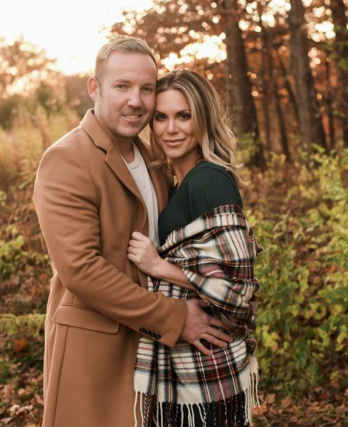 Lash Lounge owner and her NFL husband outdoors for a fall portrait