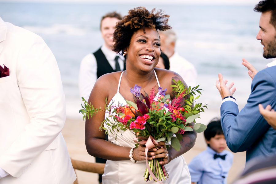 black woman with lash extensions at her wedding on the beach