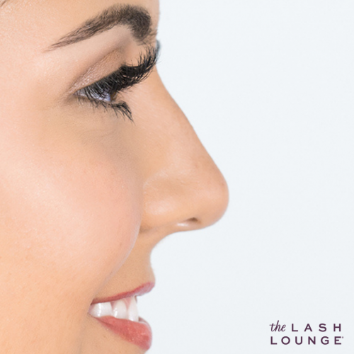 close-up side profile of a woman's face with lash extensions