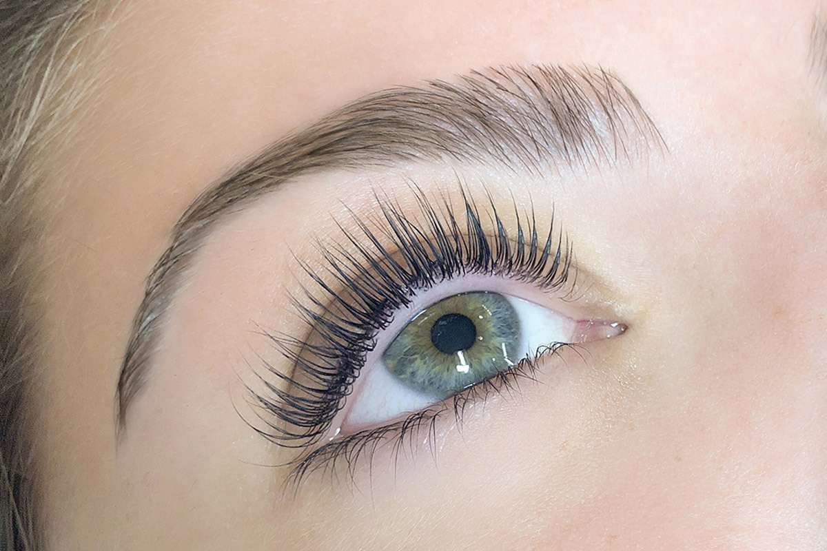 close-up of a woman's eye and brows to show her fresh brow tint