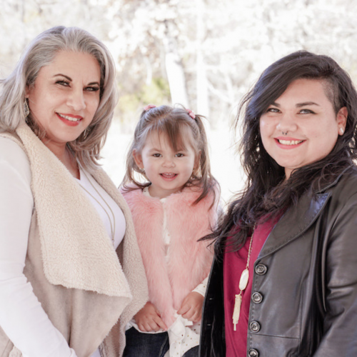 grandmother, granddaughter and daughter pictured together outdoors wearing sweaters and jackets