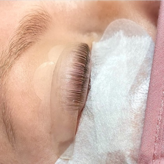 Close-up of a closed eye getting a lash lift
