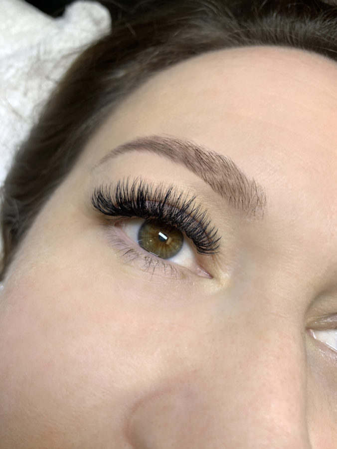 close-up of a brunette woman's eye with mega volume eyelash extensions