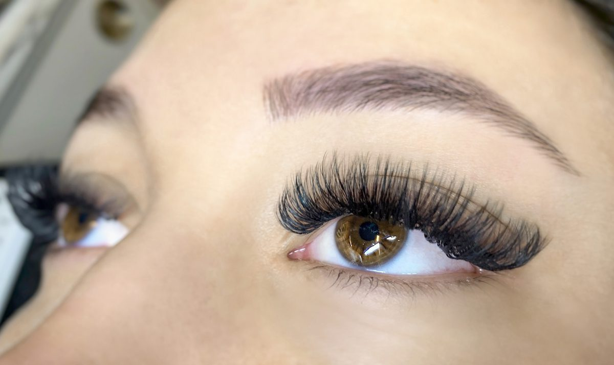 close-up of hispanic woman eyes with extreme volume lash extensions